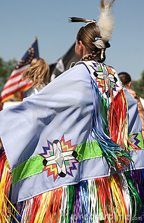 Native American woman displaying her costume at Minneapolis POW WOW