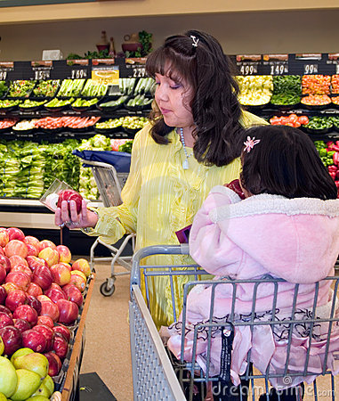 Native American woman shopping produce