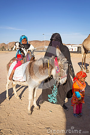 Native arabic family with donkey and goat Editorial Photo