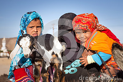 Native arabic family with donkey and goat Editorial Image