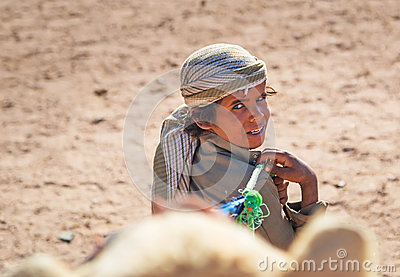 Native boy with camel in Egypt Editorial Stock Image
