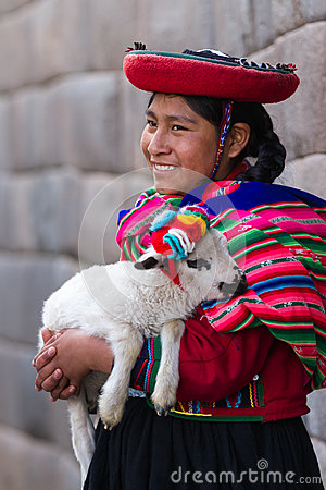 Free Native Peruvian Holding A Baby Lamb Royalty Free Stock Photos - 79764298