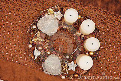 Natuaral christmas crown on brown tablecloth.
