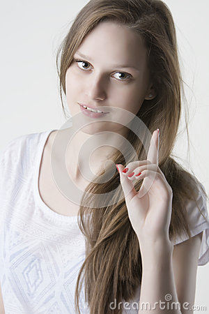 Natural beauty blond woman with her finger up