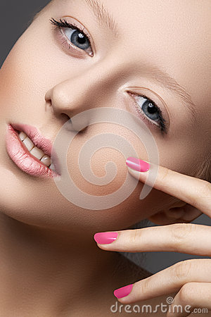 Natural beauty, clean soft skin, manicure on nails