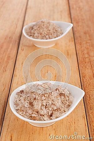 Natural Black Sea salt crystals in white bowl.
