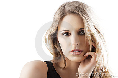 Natural blond woman with left hand near the face