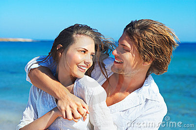 Natural couple at the beach