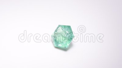 Emerald video. Natural emerald on the white background stock footage