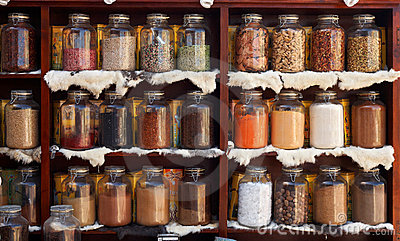 Natural food items and medical herbs in glass jars