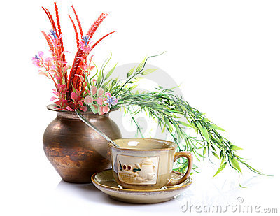 Natural herbs and tea cup