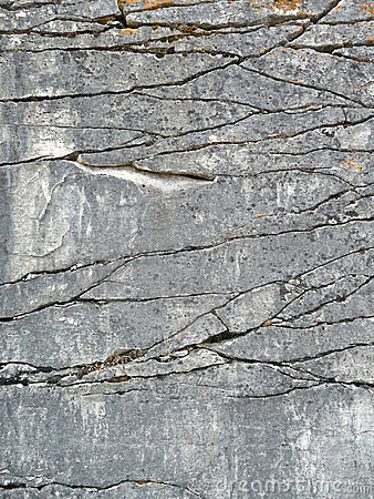 Natural rock face with fractures background