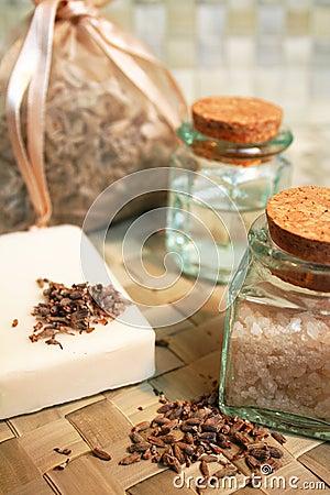 Natural soap, bottles of sea salt, dry lavender