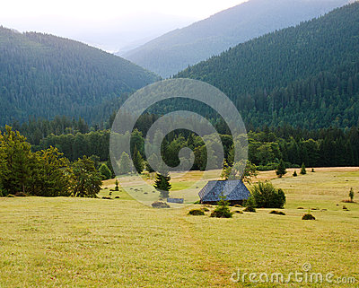 Nature background, house in the hills