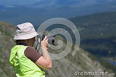 Nature photographer  on  mountain