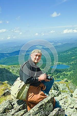 Nature photographer on mountain peak