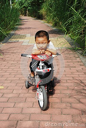 The naughty boy on a bicycle