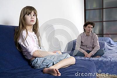 Naughty crying girl and sad father