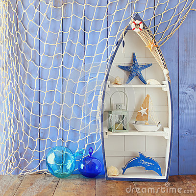 Free Nautical Boat Shape Shelves And Nautical Life Style Objects On Wooden Table. Vintage Filtered Stock Photography - 69291572