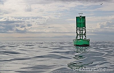 Navigational buoy in calm seas with clouds