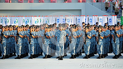 Navy contingent saluting during NDP 2012 Editorial Stock Image
