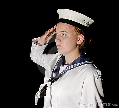 Navy seaman saluting on black