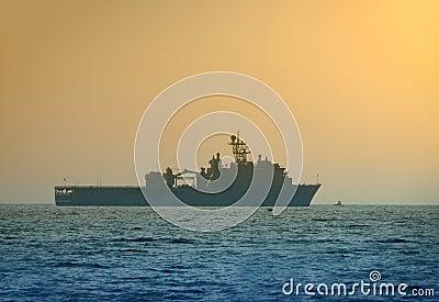 Navy ship at dawn