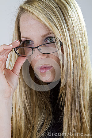 Nearsighted Beauty Looks Over Her Glasses
