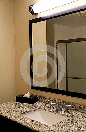 Neat And Clean Bathroom With Marble Countertop And Stainless Steel Fixtures Stock Photo Image