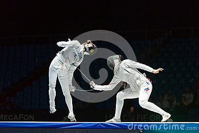 Neat trick of one of athletes on championship of world in fencing Editorial Stock Photo