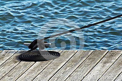 Neatly Coiled Rope on Boat Dock