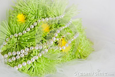 Necklace of pearls and bouquet of chrysanthemums