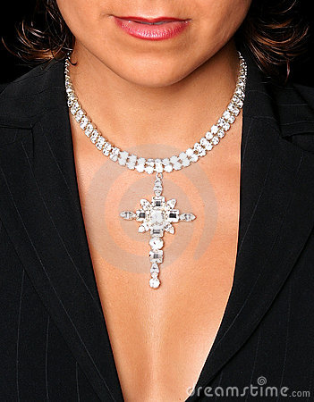 Neckline and bra-less chest of young attractive girl with diamond necklace on.