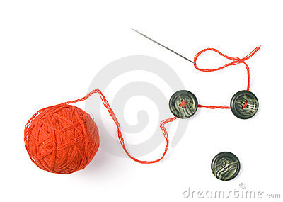 Needle with red ball of threads and buttons