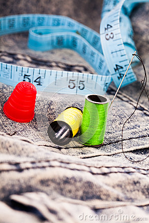 Free Needle, Reels Of Cotton And A Tape On Denim Cloth Stock Image - 36449691