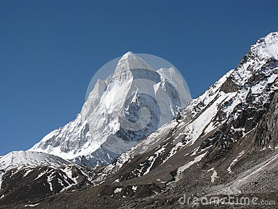 Neelkanth peak with moraine in foreground