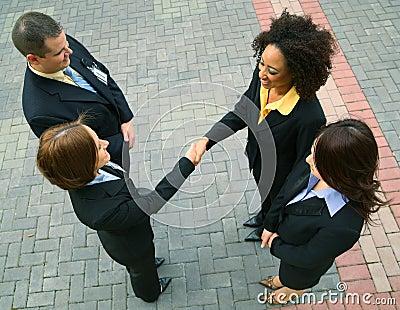 Negócio de negócio com grupo da diversidade