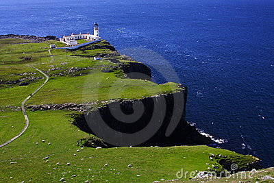 Neist Point lighthouse overhanging the blue sea