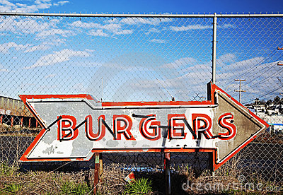 Neon burger sign in sign scrapyard