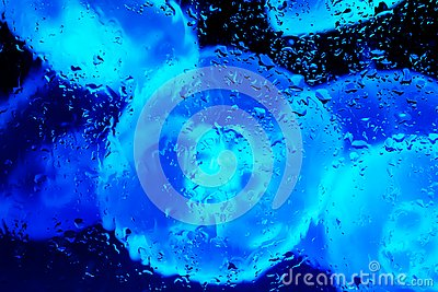 Neon lights behind water drops close up blue jellyfish sphere Stock Photo
