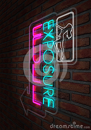 Neon Stripper Sign on A Face Brick Wall