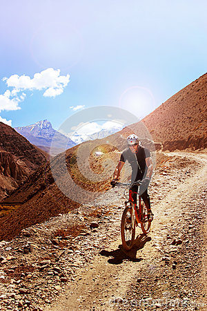 Free Nepal, Himalayas, The Kingdom Of Upper Mustang - April 2015: A Mountain Bike Cyclist Descends The Mountain Road Royalty Free Stock Photo - 88300215
