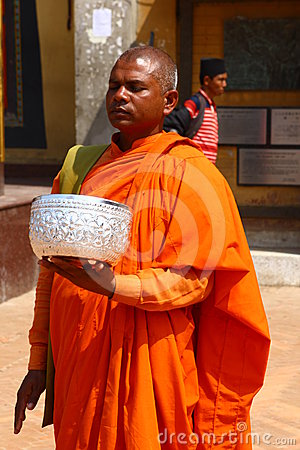 Nepal monks in bright orange clothes Editorial Stock Image