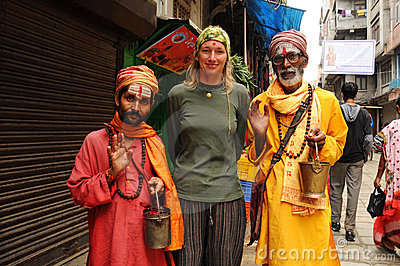 Nepalese holy men with blond tourist, Nepal Editorial Photography