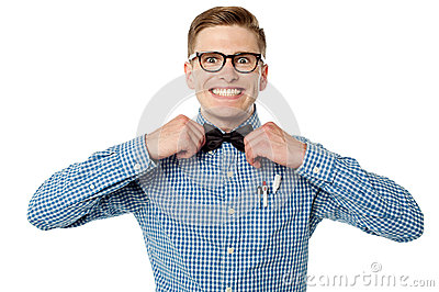 Nerd guy adjusting his bow tie