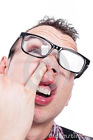 Nerd man picking nose
