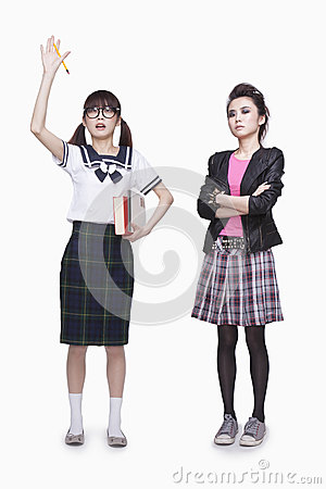 Nerd and punk girl, raised hand, opposite, studio shot