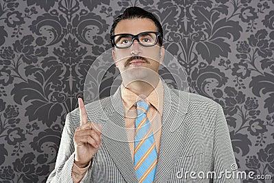Nerd retro businessman raising finger up