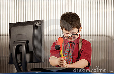 Nerdy boy smashing his computer