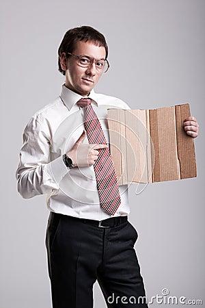 Nerdy businessman holding a cardboard